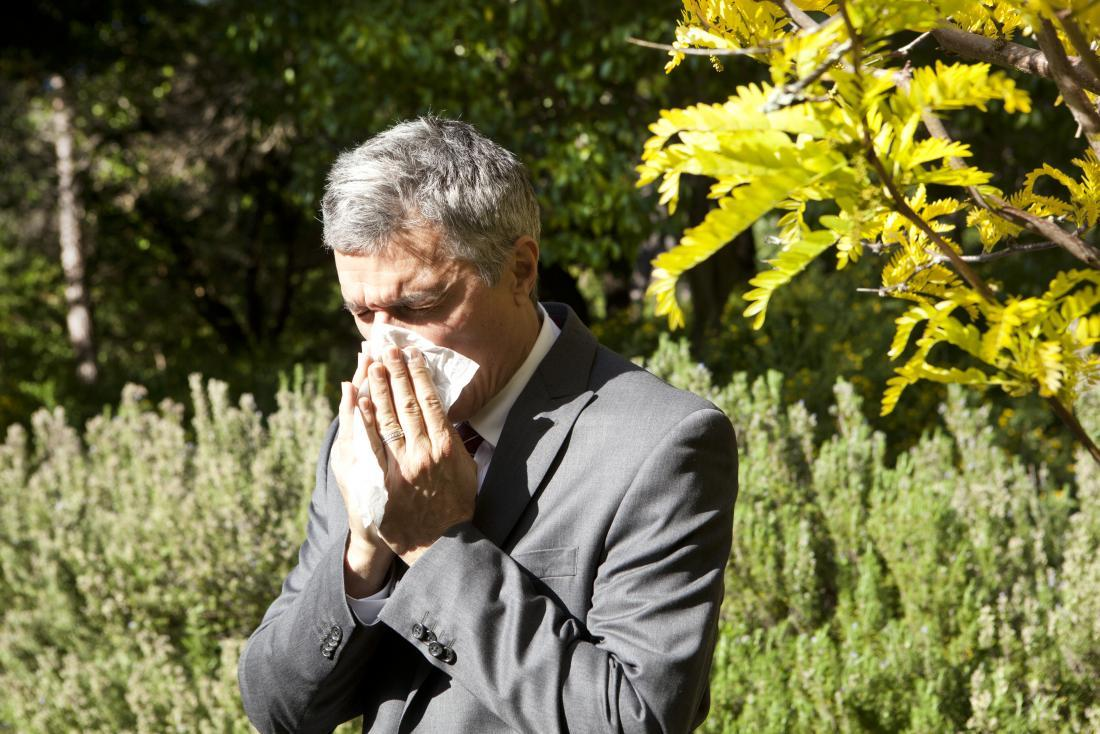 man-blowing-his-nose-outdoors-because-of-pollen-allergy